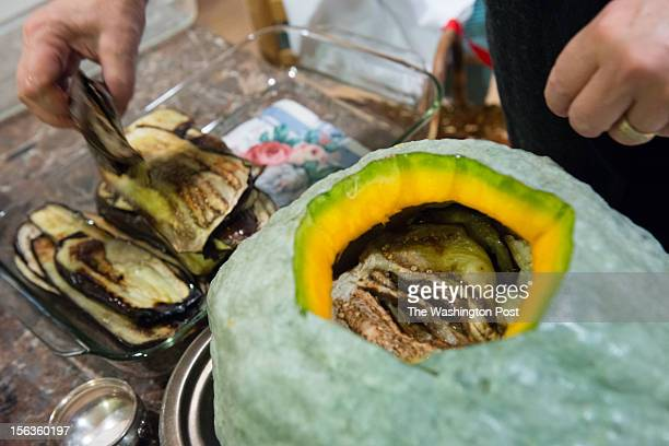 WASHINGTON DC OCTOBER DC resident Lisa Jorgenson puts together a s stuffed vegetarian Hubbard squash Eggplant is the second layer