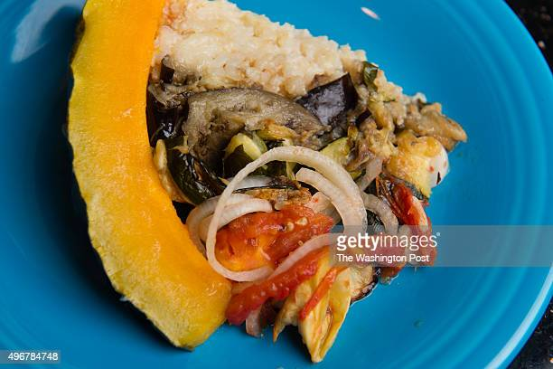 WASHINGTON DC OCTOBER DC resident Lisa Jorgenson puts together a s stuffed vegetarian Hubbard squash The layers are visible on the plate