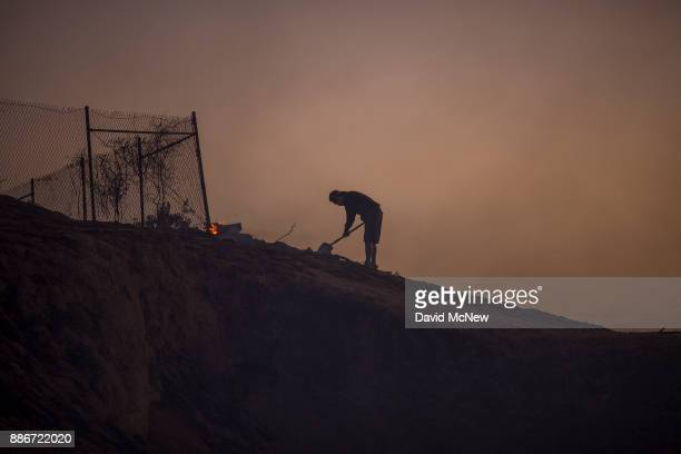 A resident looks around freshly burned property during the Creek Fire on December 5 2017 in Sunland California Strong Santa Ana winds are rapidly...