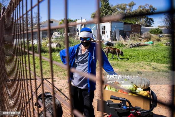 Resident looks on after receiving donated food supplies on September 06, 2021 in Wilcannia, Australia. After hearing locals in isolation were...