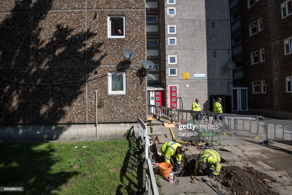 A resident looks out from his window as engineers disconnect the gas supply over safety fears on the Ledbury Estate on August 11, 2017 in London, England. Hundreds of residents of the estate are to be evacuated from four tower blocks over safety fears after a survey, ordered after the Grenfell Tower fire, found cracks in the walls leaving it vulnerable to collapse in the event of a gas explosion.