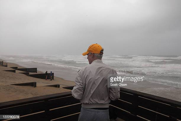 Resident looks out over the beach during Hurricane Irene August 27, 2011 in Kill Devil Hills, North Carolina. Hurricane Irene hit Dare County, which...
