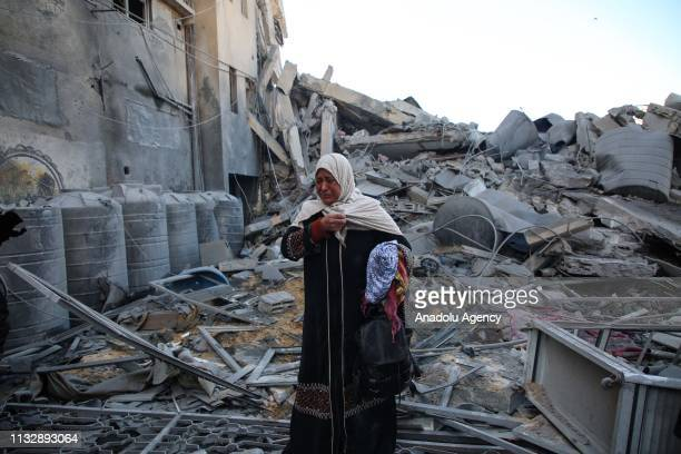 A resident Maryam El Shawa reacts at wreckage of Hassona building after Israeli warplanes carried out airstrike towards the building in Rimal...