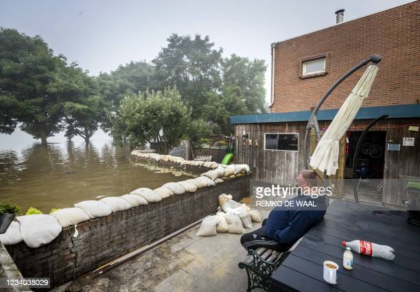 Resident monitors the flood waters from his garden, were he has been sitting over night, in the village of Well on July 18 2021, following heavy...