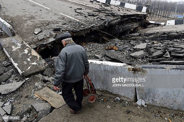 A resident negotiates a destroyed overpass in the Oktyabrsky district close to Donetsk's international airport in the selfproclaimed Donetsk People's...