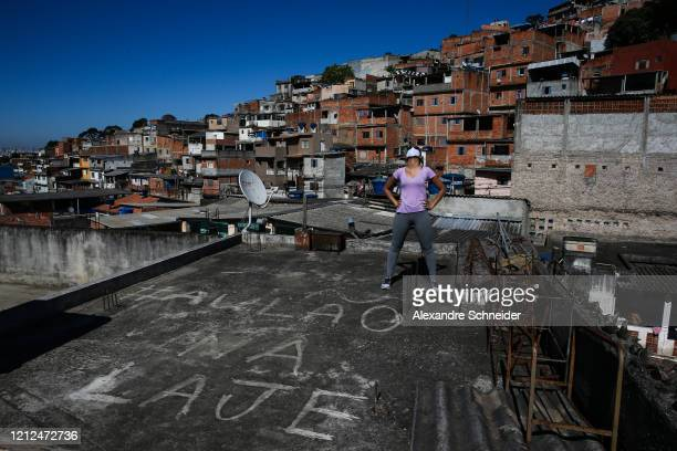 Resident of Brasilandia exercises as Ivan Pereira do Nascimento 39 years old conducts training sessions from the roof of his house amidst the...