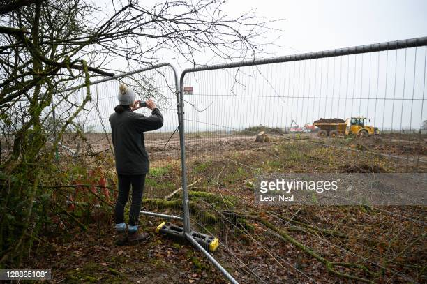 Resident of Cubbington looks through the security fencing at the cleared strip of woodland along the HS2 route, and what was previously her family's...