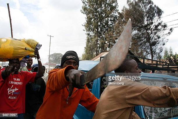A resident of Kibera shanty town waves a machete during violence linked to the disputed presidential poll in Nairobi Kenya on Sunday Dec 30 2007 Mwai...