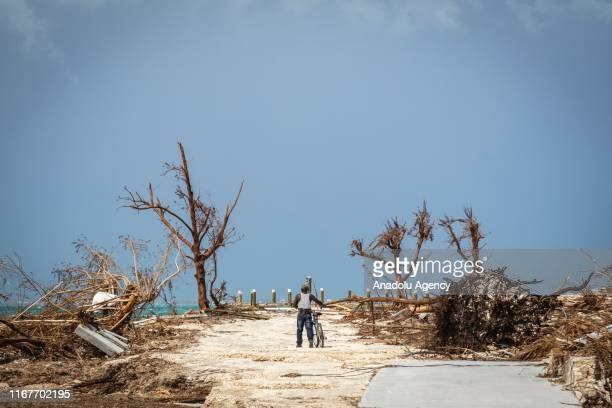Resident of Marsh Harbour walks on a empty road in Marsh Harbour on September 10, 2019 in Grand Bahama, Bahamas. The official death toll has risen in...