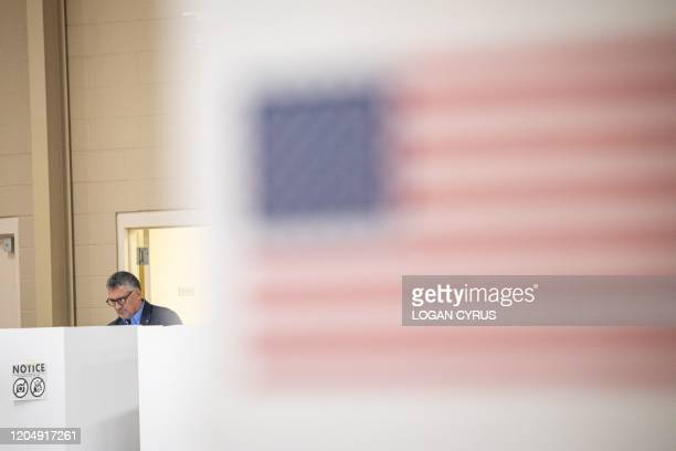 Resident of Mecklenburg County casts their vote inside the Oasis Shriners Temple polling station during the North Carolina primary on Super Tuesday...