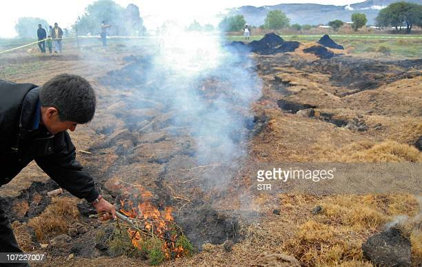 A resident of Nueva Felicidad community in Villa Rivero municipality Cochabamba department Bolivia observes a subsidence and fire coming from the...