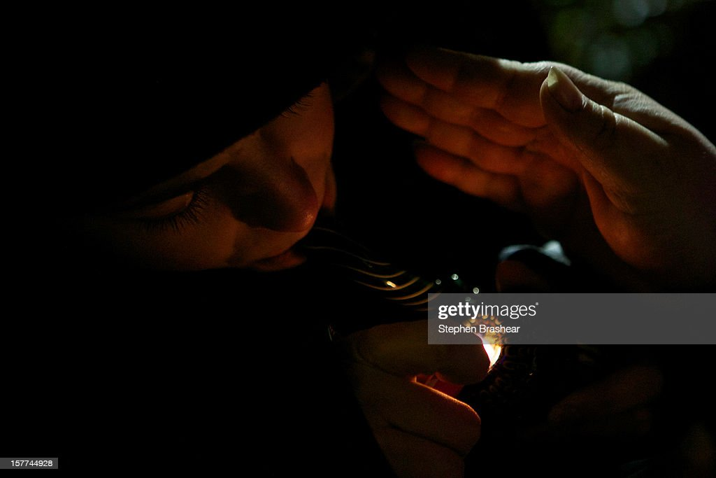 A resident of Tacoma, Washington smokes marijuana shortly before a law legalizing the recreational use of marijuana took effect on December 5, 2012 in Seattle, Washington. Voters approved an initiative to decriminalize the recreational use of marijuana making it one of the first states to do so.