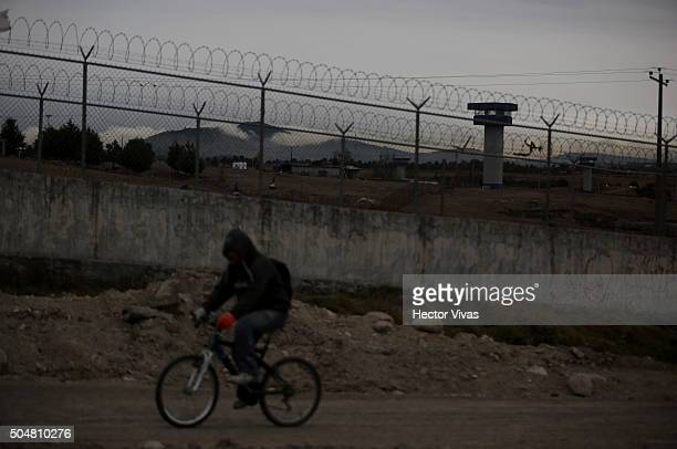 Resident of the area riding a bycicle outside prison during a walk in the vicinity of the Mexican maximum security prison 'El Altiplano' on January...