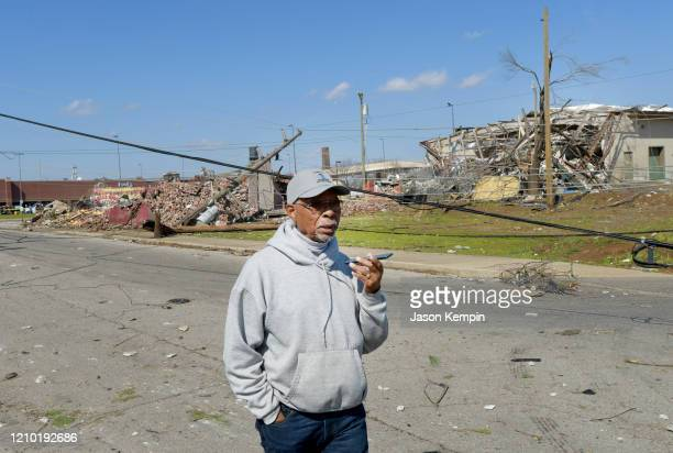A resident of the Germantown neighborhood is seen surveying the damage on March 03 2020 in Nashville Tennessee At least 22 people have reportedly...