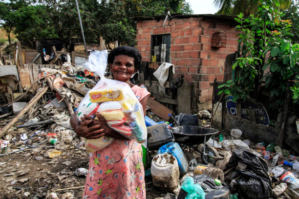 BRA: Food Distribution to Poor Resients at the Sao Goncalo Lixao Amidst the Coronavirus (COVID - 19) Pandemic