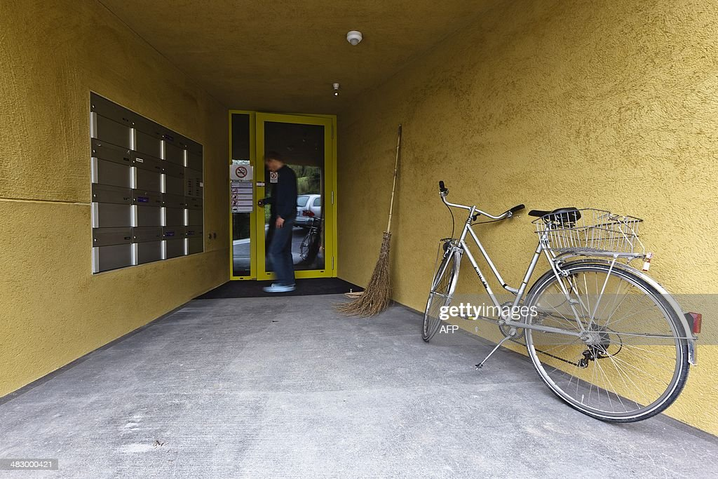 A resident of the newly opened apartment building of Swiss Healthy Life and Living Foundation for Multiple Chemical Sensitivity (MCS) patients enters the building in a remote part of Leimbach, on the outskirts of Zurich, on April 3, 2014. The building has been purpose built for people who say exposure to everyday products like perfume, hand lotion and hairspray, or electromagnetic waves from wireless devices, make them so sick they cannot function.