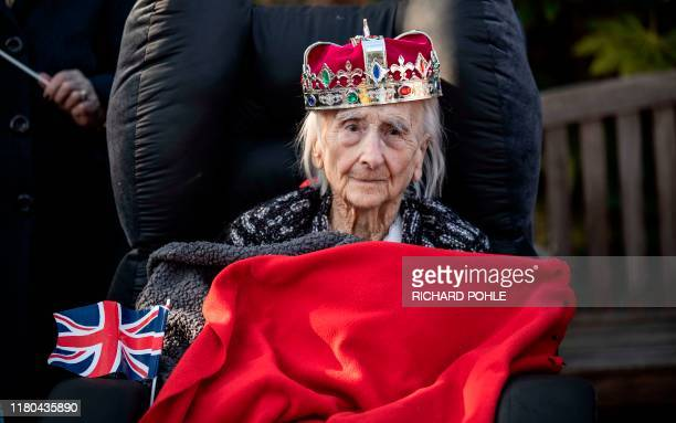 Resident of the Royal British Legion Industries village in Kent Winifred Bennett aged 101 wears a toy crown and is wrapped up against the cold as she...