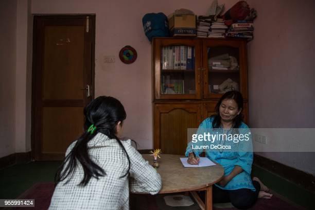 Resident of the Shakti Samuha safe house take part in counseling therapy on May 8 2018 in Kathmandu Nepal Shakti Samuha an organization started by...