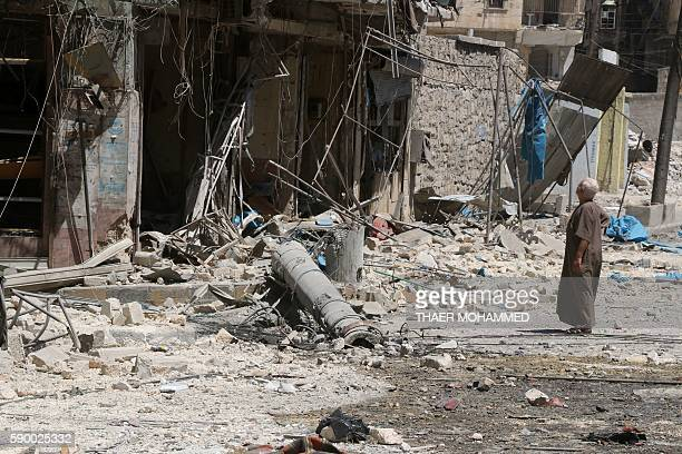 TOPSHOT A resident of the Tariq alBab neighbourhood of Aleppo inspects the damage caused by reported air raids that targetted rebelheld areas in the...