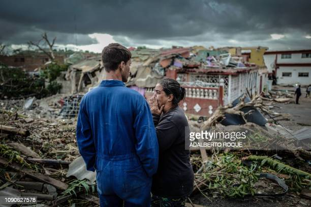 TOPSHOT A resident of tornadohit Regla neighbourhood cries in front of her destroyed house in Havana on January 28 2019 A rare and powerful tornado...