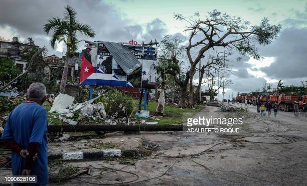TOPSHOT A resident of tornadohit Regla neighbourhood looks at destroyed buildings in Havana on January 28 2019 A rare and powerful tornado that...