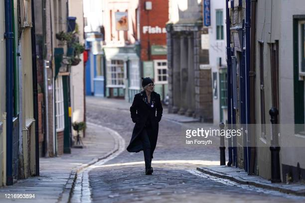 Resident of Whitby walks along a deserted street as visitors observe the guidelines during the Coronavirus pandemic lockdown on April 05, 2020 in...