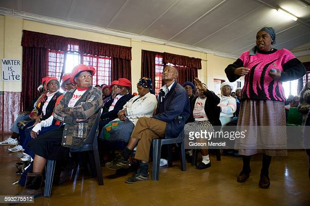 Resident of White City makes her point at a 'People's Assembly' meeting called by the Soweto Electricity Crisis Committee . They were meeting to...