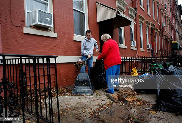 A resident of Willow Street works to clear debris before taking on his flooded basement on October 31 2012 in Hoboken New Jersey Known as the Mile...