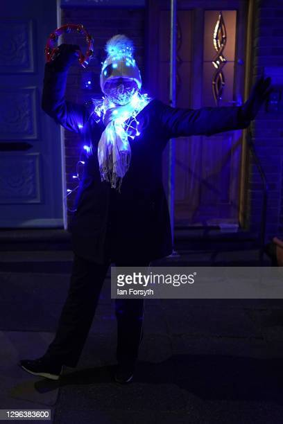 Resident on a street in Saltburn wears fairly lights as she stands outside her home and takes part in the Clap for Heroes event on January 14, 2021...