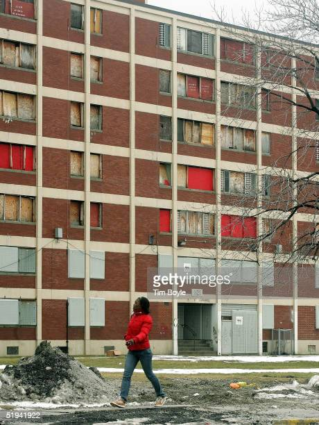 Resident Oneisha Cannady walks past one of the few remaining Chicago Housing Authority CabriniGreen public housing buildings January 12 2005 in...