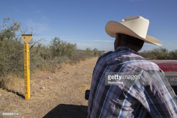 A resident passes a Sempra Energy Gasoducto de Aguaprieta gas pipeline marker in the village of Loma de Bacum Sonora state Mexico on Tuesday Dec 5...