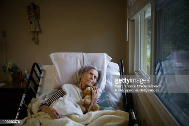 Resident Pat Michelin rests in her room at the Gordon Manor assisted-care facility in Redwood City, California on Thursday, Jan. 28, 2021. Many Bay...