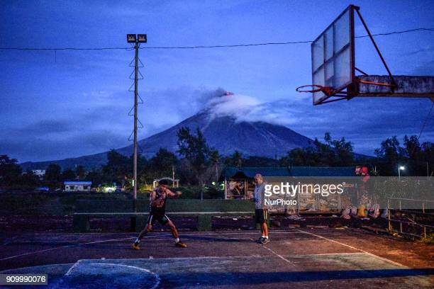 A resident practices boxing at a basketball court in Daraga Albay province Philippines January 25 2018 Mount Mayon the Philipines' most active...
