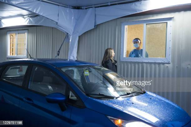 Resident receives a test at a new Covid-19 test collection center near the Vancouver International Airport in Richmond, British Columbia, Canada, on...
