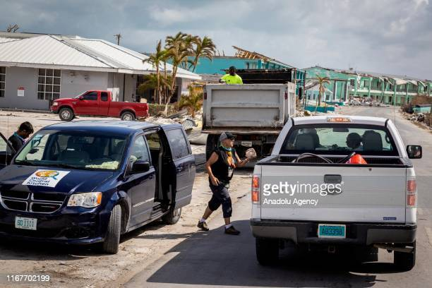 A resident receives food and water as part of relief efforts in the aftermath of Hurricane Dorian on September 10 2019 in Grand Bahama Bahamas The...