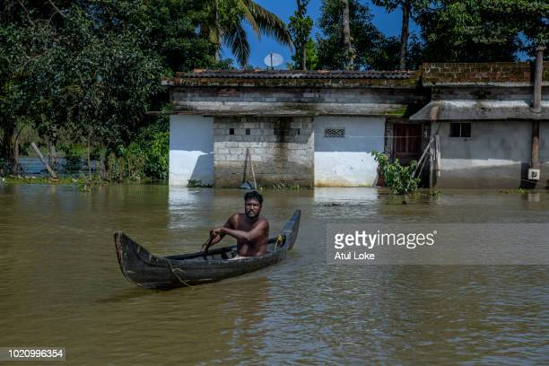 Resident rushes to receive relief material distributed by the BSF water wing on August 21, 2018 in Kerala, India. Over 400 people have reportedly...