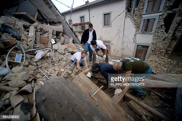 Resident search for victims in the rubble after a strong earthquake hit Amatrice on August 24, 2016. Central Italy was struck by a powerful,...