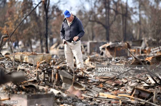 A resident searches through rubble at his burned property in Santa Rosa California on October 20 2017 Residents are being allowed to return to their...