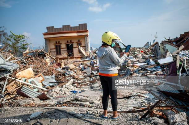 Resident seen standing next to the ruins of a building that was destroyed by the earthquake. A deadly earthquake measuring 7.5 magnitude and the...