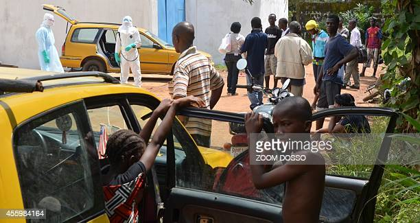 A resident sick from ebola virus arrives by taxi on September 23 2014 at the Island Clinic a new Ebola treatment centre that opened in Monrovia The...