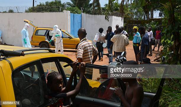 A resident sick from ebola virus arrives on September 23 2014 at the Island Clinic a new Ebola treatment centre that opened in Monrovia The first...