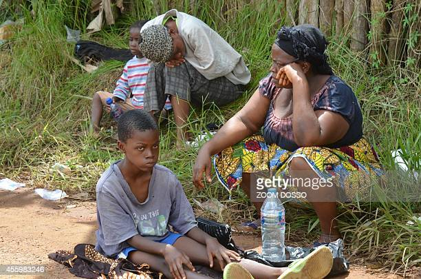 A resident sick from the ebola virus waits on September 23 2014 outside Island Clinic a new Ebola treatment centre that opened in Monrovia The first...