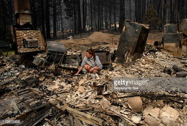 Resident sifts through what used to be her kitchen in South Lake Tahoe, California, June 26, 2007.
