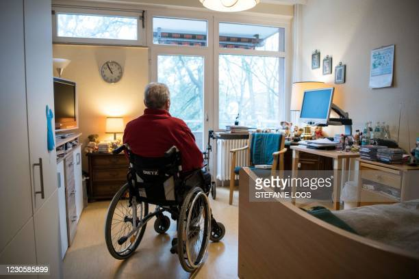 Resident sits in a wheelchair in his room in a nursing home in Berlin on January 14 amid the novel coronavirus pandemic.