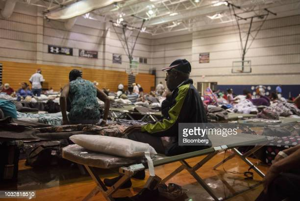 A resident sits on a cot at an evacuation shelter ahead of Hurricane Florence at the Southeast Raleigh High School in Raleigh North Carolina US on...