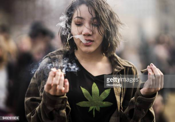 A resident smokes a marijuana joint during the 420 Day festival on the lawns of Parliament Hill in Ottawa Ontario Canada on Friday April 20 2018...
