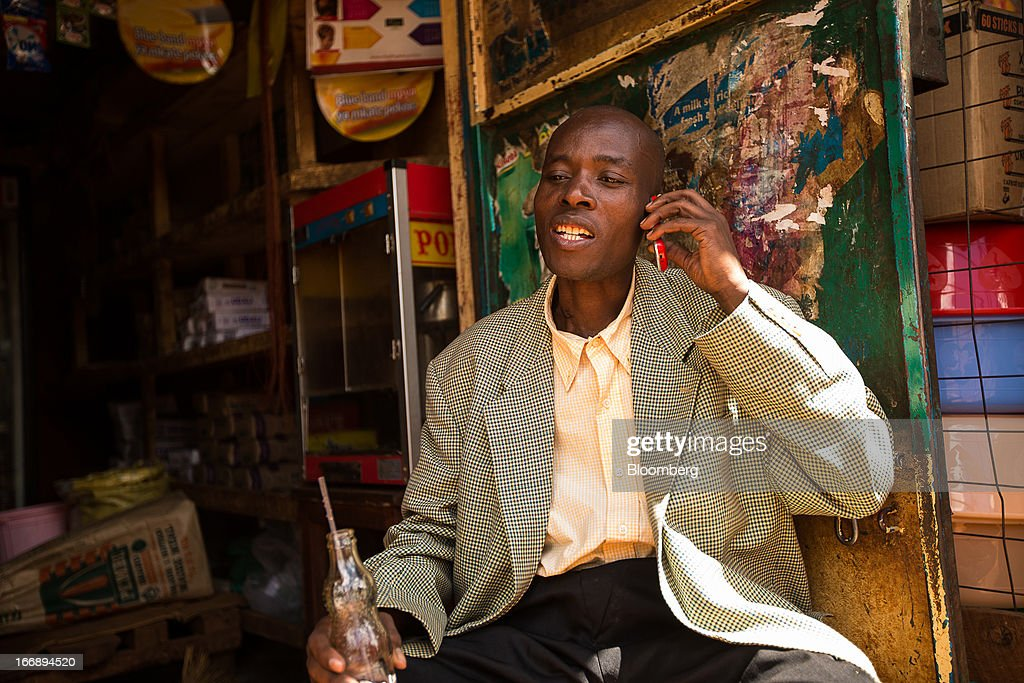 A resident speaks on a mobile phone in Nairobi, Kenya, on Sunday, April 14, 2013. In the six years since Kenya's M-Pesa brought banking-by-phone to Africa, the service has grown from a novelty to a bona fide payment network. Photographer: Trevor Snapp/Bloomberg via Getty Images