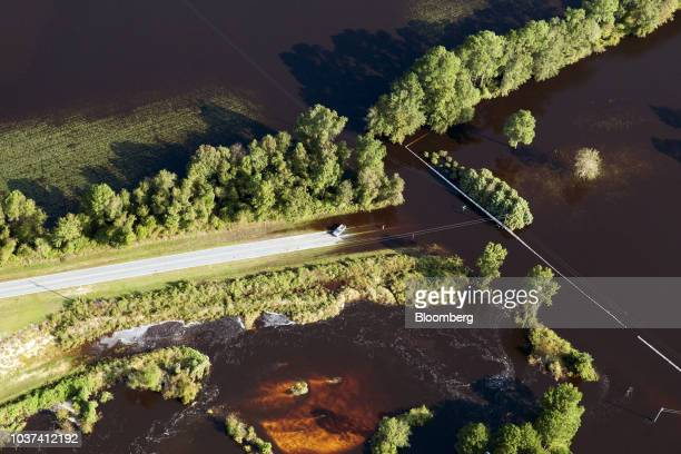 A resident stands on a flooded street in this aerial photograph taken above New Bern North Carolina US on Friday Sept 21 2018 Record floods cover...