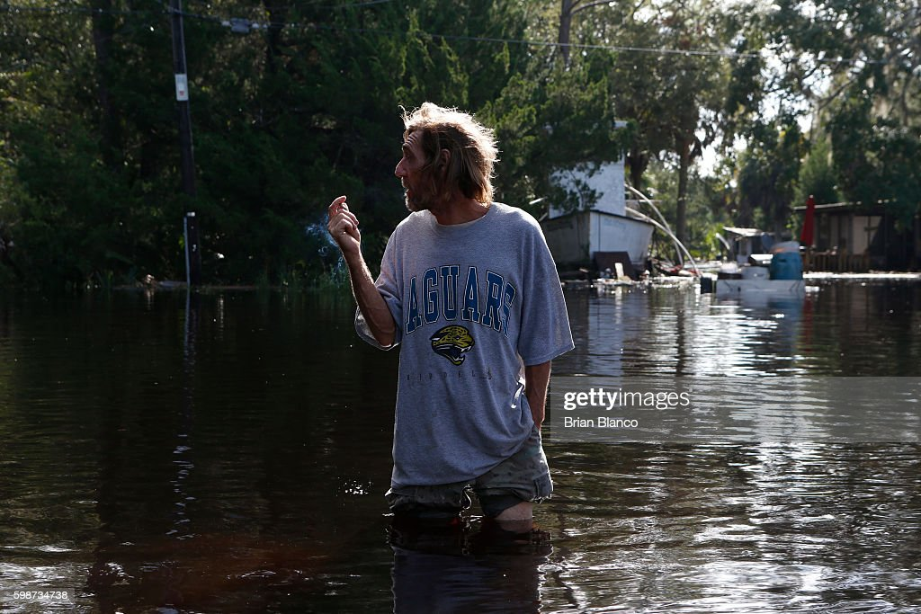 A resident surveys damage around his home from high winds and storm surge associated with Hurricane Hermine which made landfall overnight in the area on September 2, 2016 in St. Marks, Florida. Hermine made landfall as a Category 1 hurricane but has weakened back to a tropical storm.