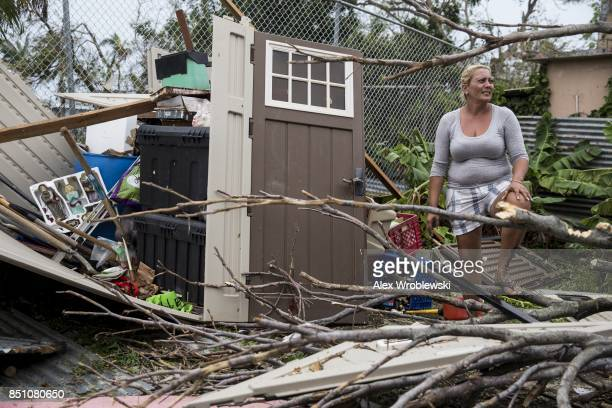 A resident surveys the damage on her property after Hurricane Maria made landfall September 21 2017 in the Guaynabo suburb of San Juan Puerto Rico...